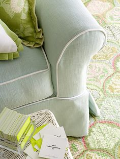 Smart Fabric Choices, Designer Carrie Miller translated the family's laid-back style into her picks for furniture and accents. The sofas are slipcovered in a washable cotton. She used textured, patterned rugs throughout the home, including this one in the family room, to camouflage dirt and stains.