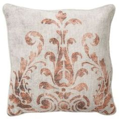 Cotton and linen pillow with damask motif and feather down fill.