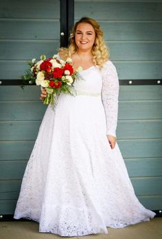 Plus size lace corset wedding gown with long sleeves on a real bride. Rinat. Studio Levana