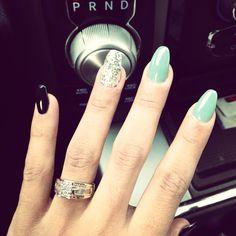 Tiffany blue, sparkly, black nail art. Coffin nails shape.