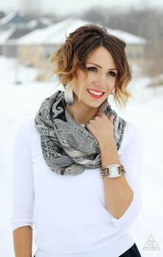 Add statement accessories like a scarf and chunky earrings to a casual outfit.