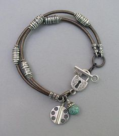 leather cord and silver padlock bracelet with turquoise accent bead
