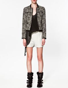 Staple: a good blazer.    Stick with neutrals, like black that can be paired with other trendy pieces (I am thinking studded accessories, or something neon)   This one reminds me of Chanel, but the price is much more reasonable. $89.90 gets you this staple.    Found @ Zara