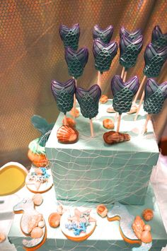 Mermaid tail cake pops at a Little Mermaid girl birthday party!  See more party ideas at CatchMyParty.com!