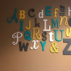 Amber DeLucenay added a photo of their purchase Wooden Alphabet Letters, Alphabet Wall, Painted Letters, Letter Wall, Kids Routine Chart, Daycare Spaces, Abc Wall, Red Barns, Nursery Decor
