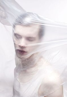 Artyom Shabalov by Dorothée Murail - cling film to distort the body | plastic | milk | fashion editorial