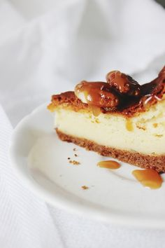 The cake is topped with Caramelized Irish Whiskey Pecans. | How To Make Delicious Irish Cheesecake For St. Paddy'sDay