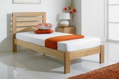 Our Goodwood Bed Frame flaunts a modern profile, designed with a high slatted headboard in a rectangular shape and a low footboard. Crafted from a beautiful solid American white oak that promises durability and versatility to last you well, and is finished with lightweight protective lacquer. Resting on four robust leg