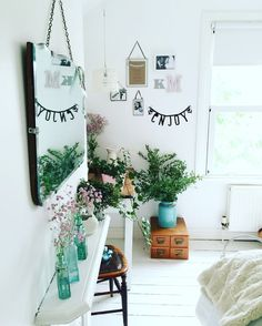 lovely white room with decorative turquoise glass bottles
