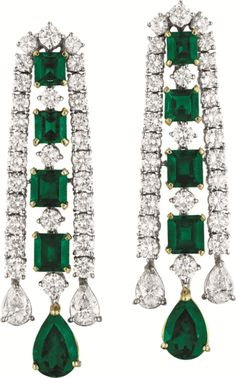 Pair of Emerald And Diamond Ear Pendants Of Chandelier Design, Centering Upon A Line Of Alternating Graduating Circular-Cut Diamonds And Square-Cut Emeralds, Within Circular-Cut Diamond Borders, Suspending Two Pear-Shaped Diamonds And A Larger Pear-Shaped Emerald, Mounted In 18k White Gold  -  Phillips