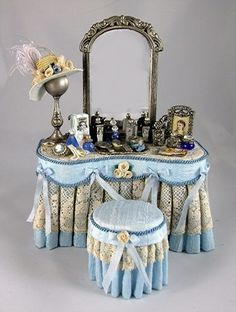 Miniature Ladies Vanity draped in pale blue silk dupioni fabric, with an antique lace overlay and tufted stool Vitrine Miniature, Miniature Dollhouse Furniture, Miniature Rooms, Miniature Crafts, Diy Dollhouse, Dollhouse Miniatures, Vintage Dollhouse, Accessoires Barbie, Mini Things