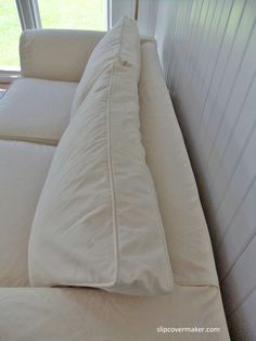 Sofa slipcover made with a #12 duck cloth (more densely woven than a 12 oz. duck.) Love the casual, relaxed look.