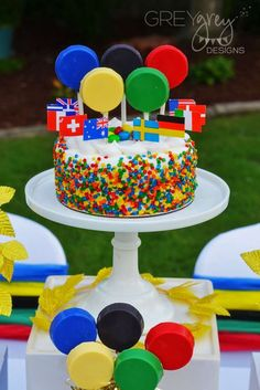 Colorful cake at an Olympics summer party! See more party planning ideas at CatchMyParty.com!