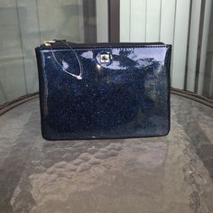 Kate Spade Mini Pouch Tag is unattached, inside the bag. Authentic Kate spade Mavis Street mini pouch in blue glitter. Has a zip top closure. Two card slots on the inside. Never been used.                  Measurements: 6.5L x 4.75H.                         Price is negotiable.❌TRADES❌ kate spade Bags Cosmetic Bags & Cases