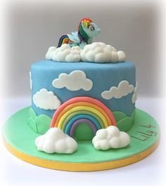 A My Little Pony themed cake made for a little girls 4th birthday. She loves Rainbow Dash and so I made one from Sugar paste to sit on top of the cake. The rainbow and clouds were also handmade. Vanilla sponge with vanilla buttercream and raspberry jam filling.