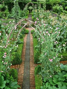 I like the way this looks. It seems relaxing and serene, like a place you'd find a fairy or two playing around. It was originally described as a Formal French Kitchen Garden with Twig Arbors for Peas
