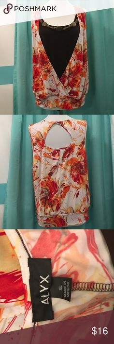 Alyx coral blouse with necklace Bright fun colors, perfect for summer! Includes the necklace. Size XL. Peephole back design. alyx Tops Blouses