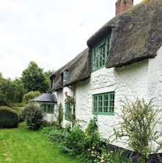 Country living, country life, wiltshire cottage, thatched cottage, green windows, stone cottage, english cottage garden
