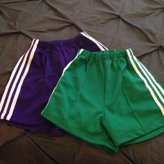 Bundle: Cheer Shorts 2 pair of cheer shorts from Pep Supply. Like new! Similar to the Varsity brand. Green are Medium. Purple are Large. Both fit similarly. Shorts