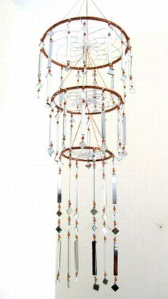 dreamcatcher chandelier... Love for Lizzy but, surely must add gorgeous feathers all around!!! ;)