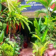 The entrance to our hotel. It's the bargain price of 12/$18 a night and has a cute pool.  Where's the cheapest loveliest place you've stayed?  #travel #DH #cambodia