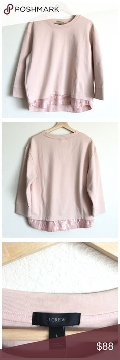 "NEW J.Crew Blush Pink Sequin Hem Sweatshirt Top Cute sequin details make this sweatshirt sparkle!  Features: Scoop neckline Long sleeves Layered sequin hemline Pull-on style  Materials: Cotton Polyester  Sizing: Size Large Bust- 42"" Waist- 45"" Sleeves- 18"" Total Length- 26.5"" **Please note that measurements are approximate.  Condition: New with tags.  A couple sequins missing throughout, but overall this item is in great condition.  Natural wear throughout due to storage.  VW.B16.0917. J…"