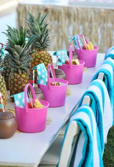 Kids Pool Party Table with Pineapple Centerpieces