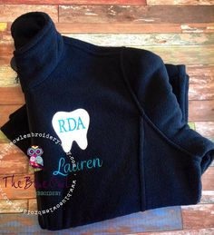 This exceptionally soft, mid-weight fleece jacket will keep you warm in the hospital, office, or during everyday excursions. Add your monogram or initial in the tooth, add your name and title below the tooth, or mix it up. You can also add an office name below the tooth. Ill be glad to work with you to create a special piece just for you.  The tooth is approximately 3.5 x 4. Please put the following information on the notes to seller section at checkout. In order to expedite your order…