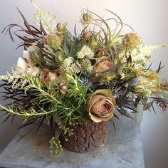 love the colours in this woodsy arrangement with roses, thistle, rosemary and tillandsia - Sullivan Owen Floral Design, Philadelphia