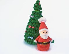 Christmas Toy Set - Christmas tree and Crocheted Santa Claus   This set of toys will decorate your house for Christmas.  Crocheted Santa Claus and the Christmas tree are very cute and pleasant. This Christmas set will be an excellent gift to a friend or child.   Height of the Christmas tree 23 cm (9.06)  The width at the bottom is 11 cm. (4.33)  Bows just lie on the branches of the Christmas tree.   Height crocheted Mrs. Santa Claus 12 cm ( 4.72 )  Down the diameter of the toy 5.5 cm ( 1.97…