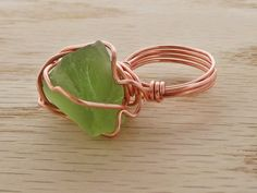 Men's/unisex freeform wire wrapped;seafoam green sea glass ring. Ring is approximately a size9.5 and may be sized or custom made upon request. Raw copper is used and will naturally patina over time. No two pieces will be the same.