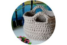 "Chunky Crocheted Basket Pattern, made with super bulky yarn and L hook. sm- 8.5"" dia x 5.5"" h. LG- 10dia x 10h."