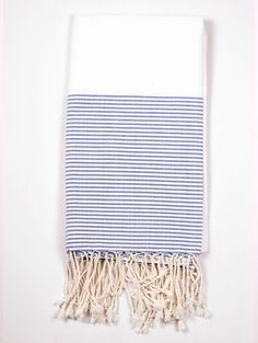 Turkish towel in bright white with preppy stripes of navy and white.