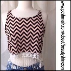 The Vanda Racerback Lace Trim Crop Top Chevron crop tank top with white lace fringe. Made in the USA. Versatile! New. No Trades. Measurements & Sizing are for guidance only. Fit not guaranteed. All sales final. Ask questions prior to purchasing. I want happy customers! Price firm unless bundled. Thanks for visiting & Happy Poshing! April Spirit Tops Tank Tops