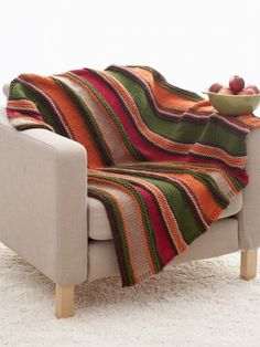 Free Pattern - Bright and bold stripes add serious style to this simple #knit blanket. Shown in Bernat Softee Chunky.