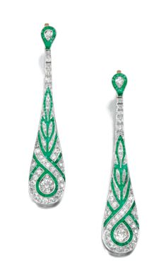 PAIR OF EMERALD AND DIAMOND EAR PENDANTS | lot | Sotheby's - Each tapered drop millegrain-set with calibré-cut emeralds, highlighted with circular-cut diamonds, hinged post fittings.  $8,948.88 USD (includes Buyer's Premium) - 2011.
