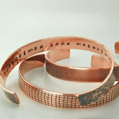 """Textured copper cuff inscribed with """"Ndakasimba kana makasimbawo"""" which means """"I am strong if you are strong"""" in the Shona language--which you may recognize from the song """"Elias"""" by Dispatch. $35"""