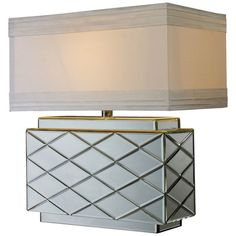 Mirrored table lamp with a cream shade.     Product: Table lamp    Construction Material: Mirrored glass and metal $141