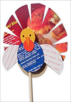 Make a turkey out of old cereal boxes and a wooden dowel. PDF tutorial available. #artprojectsforkids #recycled #turkey