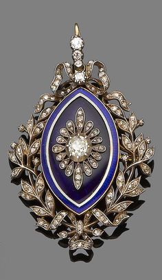 An enamel and diamond brooch/pendant, circa 1910. The navette-shaped plaque decorated royal blue and white guilloché enamel, set to the centre with an old brilliant and rose-cut diamond flowerhead, within an openwork wreath tied with ribbons and set throughout with rose-cut diamonds, glazed compartment to the reverse