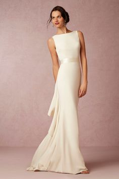 Love the simple front and dramatic back of this gown.  I wonder if it could be customized to be more modest for a temple wedding?