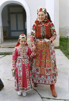 Portrait of a woman and child wearing traditional clothes, Inaktelke, Romania