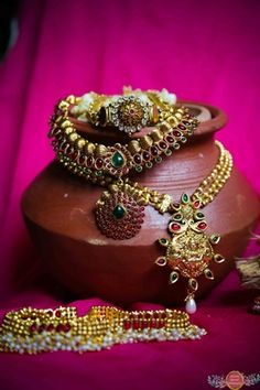 Indian Wedding Jewelry - Traditional South Indian Gold Jewelry   WedMeGood   Gold Bridal Neckaces with Ruby and Emerald Stones and Gold Anklets with Pearl Beads   Photo Credits: Sunanda Agarwal Photography #wedmegood #south #indian #jewelry