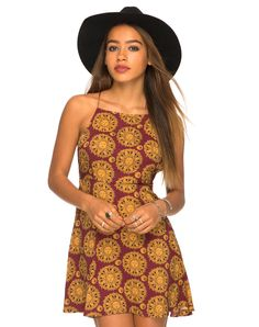 You'll be a total boho goddess in this gorgeous printed skater dress. Featuring a sexy open back with delicate thin straps.