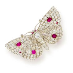 A diamond and ruby butterfly brooch, French set throughout with old mine, European, rose and single-cut diamonds, highlighted with collet-set oval and marquise-cut rubies; with French assay marks; estimated total diamond weight: 16.50 carats; mounted in platinum and white gold.