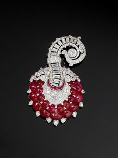 Turban Ornament or Brooch, ca. 1935, probably France. Platinum, set with rubies and diamonds. The Al-Thani Collection (Photo: © Prudence Cuming Associates)