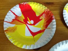 Flame: Creative Children's Ministry using a salad spinner for spin art and creating the flames of Pentecost. Love it