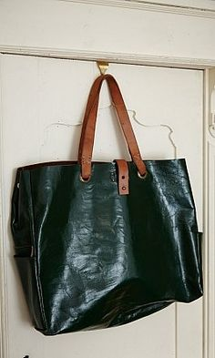 Var Leather Bag - glossy dark-green leather tote with contrasting tan leather carry handles and closure strap.