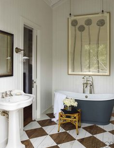 Rustic inspired bathroom with a freestanding tub, and checkered floors
