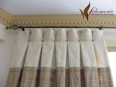 Inverted pleats, not sewn all the way up to top of curtain, with button detail